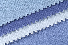 Composition of colored diagonal stripes of serrated cotton fabric. Place for text stock photography