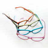 Composition of colored glasses on white background Royalty Free Stock Photo