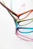 Composition of colored glasses on white background stock image
