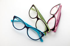 Composition of colored glasses on white background royalty free stock images