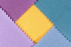 Composition of colored pieces of serrated cotton fabric.  Stock Photography