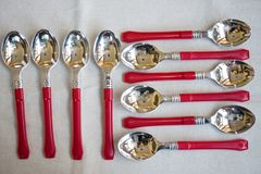 Composition of colored silver dessert spoons Stock Image