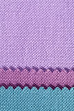 Composition of colored stripes of serrated cotton fabric. Place for text Royalty Free Stock Photo