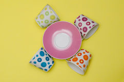 Composition with colorful cups and saucer Royalty Free Stock Photography