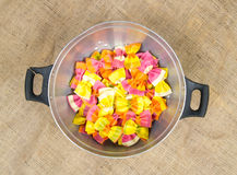 Composition of colorful pasta in a metal strainer stock image