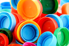Composition with colorful plastic bottle caps Stock Photos