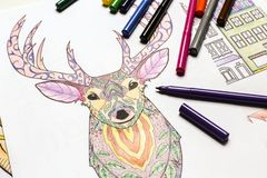 Composition of colouring pictures and felt-tip pens. Closeup Royalty Free Stock Photography