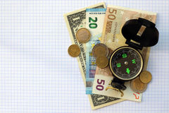 Composition - compass money on a checkered sheet background Stock Photo