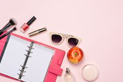 Composition with computer keyboard, cosmetics and flowers on col royalty free stock photo