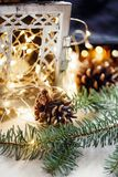 Composition of cones, candlestick branches. Christmas motives royalty free stock photography