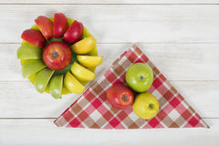 Composition consisting of whole and sliced apples stock photography