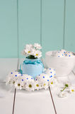 The composition consists of Easter eggs and spring flowers Royalty Free Stock Photos