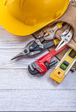 Composition of construction tooling in leather tool belt buildin Royalty Free Stock Photography