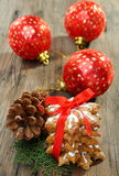 Composition of cookies and Christmas tree balls. Royalty Free Stock Images