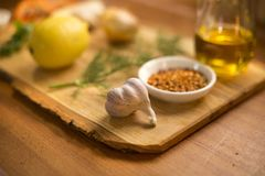 Composition with cooking ingridients on a wooden plate Stock Image