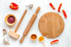 Composition of cooking tools and spices on kitchen table top view Stock Image