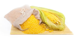 Composition from corn, maize flour in sack on the mat Royalty Free Stock Images