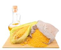 Composition from corn, maize flour in sack, oil on the mat Stock Images