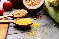 Composition of corn seeds and groats. On wooden table Royalty Free Stock Photos