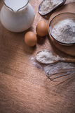Composition corolla eggs flour in bowl and spoon Royalty Free Stock Photography