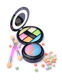 Composition of cosmetics with coloured eyeshadows, face powder balls and applicators. Composition of cosmetics with coloured eyeshadows in open box, corrector royalty free stock photo