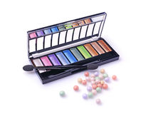 Composition of cosmetics with coloured eyeshadows and face powder balls Royalty Free Stock Images