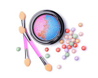 Composition of cosmetics with eyeshadows, face powder balls and applicators Stock Photos