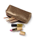 Composition of cosmetics with golden cosmetic bag Royalty Free Stock Image