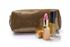 Composition of cosmetics with golden cosmetic bag Stock Photo