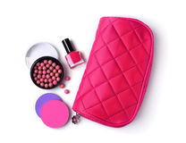 Composition of cosmetics with nail polish, ball blush, sponges and cosmetic bag Stock Photos