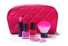 Composition of cosmetics with nail polishes, blush, lipstick, brush and cosmetic bag Royalty Free Stock Image