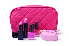 Composition of cosmetics with pink cosmetic bag Stock Photo