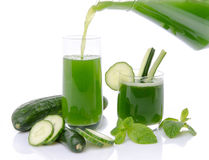 Composition with cucumber juice poured into a glass Royalty Free Stock Image
