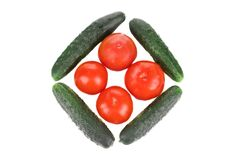 Composition from cucumber and tomato. Royalty Free Stock Images