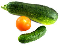 Composition from cucumber, tomato and vegetable marrow isolated Royalty Free Stock Photos