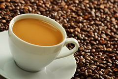 Composition with cup and coffee beans Stock Images