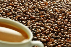 Composition with cup and coffee beans Stock Photo