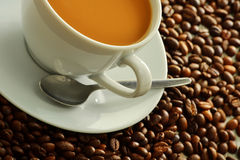 Composition with cup and coffee beans Royalty Free Stock Photos