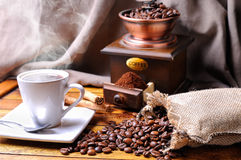 Composition with a cup of coffee, beans and coffee grinder Royalty Free Stock Photo