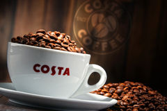 Composition with cup of Costa Coffee coffee and beans Stock Image
