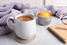 Composition with cup of hot chocolate and notebook on windowsill. Winter drink stock photos