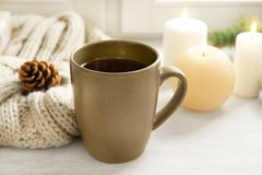 Composition with cup of hot winter drink on table. Cozy season stock photo