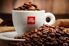 Composition with cup of Illy coffee and beans Royalty Free Stock Image