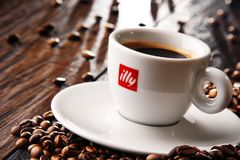 Composition with cup of Illy coffee and beans Stock Images