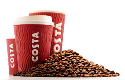 Composition with cups of Costa Coffee coffee and beans Stock Photos