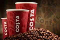 Composition with cups of Costa Coffee coffee and beans Stock Image