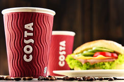Composition with cups of Costa Coffee coffee and sandwich Stock Photos
