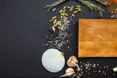 Composition with a cutting board, spices on a wooden background Stock Photo