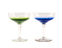 Composition of dark blue and green colored cocktails on a white background Royalty Free Stock Photos