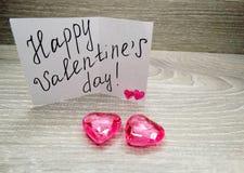 Composition de jour du ` s de Valentine de carte de voeux et de coeurs Photographie stock